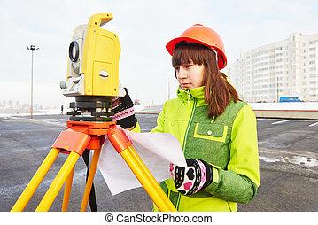 surveyor works with theodolite - female surveyor worker ...