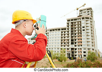 surveyor works with theodolite - One surveyor worker with ...