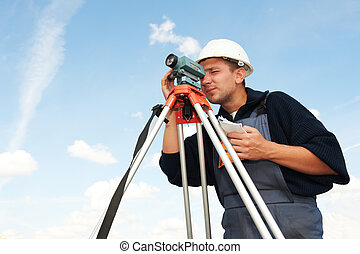One surveyor worker with tilting level equipment outdoors input the data