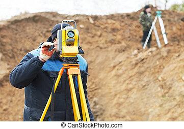 surveyor works with total station tacheometer - Surveyor...