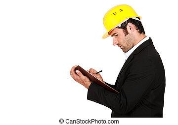 Surveyor writing on a clipboard