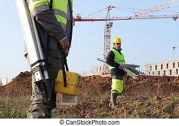 surveyors on a construction site