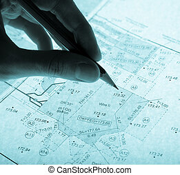 surveyor\'s plan and pencil with backlight