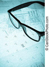 surveyor\'s plan and retro glasses with backlight