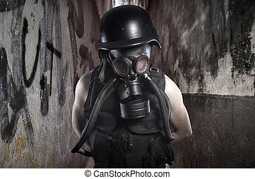 Survival. Environmental disaster. Post apocalyptic survivor in gas mask