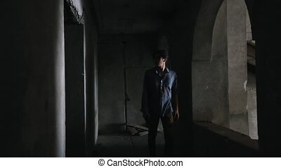 Survived man walking in the dark in abandoned building....