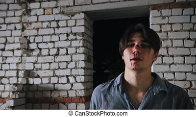 Survived man with broken nose walking on a abandoned...