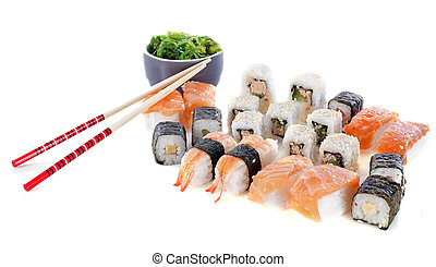 sushi and algae in front of white background
