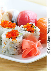 Sushi and california rolls on a plate close up