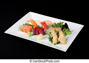 sushi and sashimi with wasabi and vegetable in white plate ...