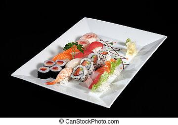 sushi and sashimi with wasabi on plate