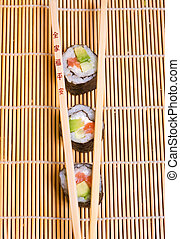 Sushi and wooden chopsticks