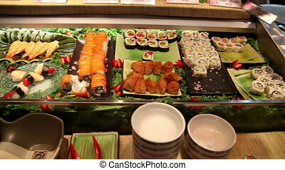 Sushi buffet - Pan over a buffet section