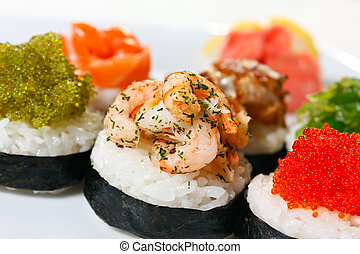 Sushi Canape with eel, shrimp, tobiko caviar, wasabi and salmon