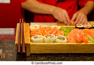 Different kinds of sushi on a wooden plate