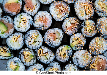Sushi - Different kinds prepared on the plate - A number of...