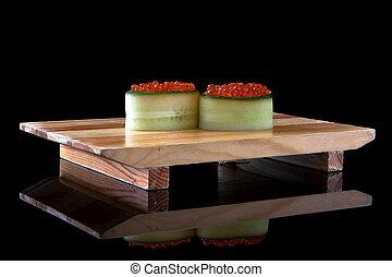 sushi gunkan ikura on wooden tray
