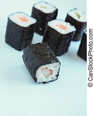 Sushi hoso maki on a kitchen table