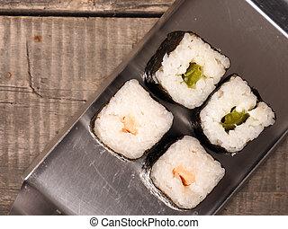 Sushi Hoso maki - Sushi hoso maki on a stell plate top view