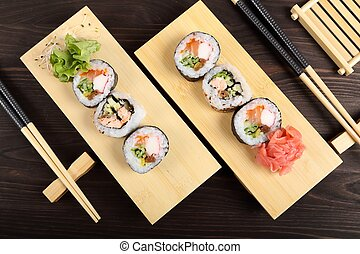 Sushi. - Japanese food, sushi with ginger and lettuce on...
