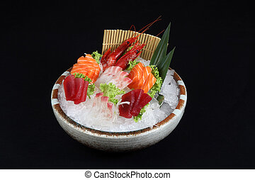 sushi mixed with ice and decoration of vegetables on a black...