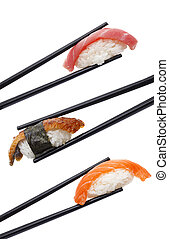 Sushi nigiri set in chopsticks isolated on white background