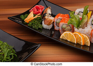 sushi on a black plate