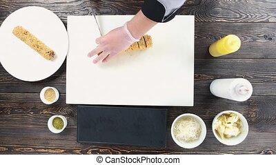 Sushi on cutting board. Chef preparing unagi maki rolls.