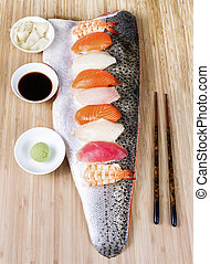 Sushi on Large Salmon Fillet serving as plate - Vertical...