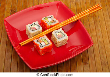 sushi on wooden background