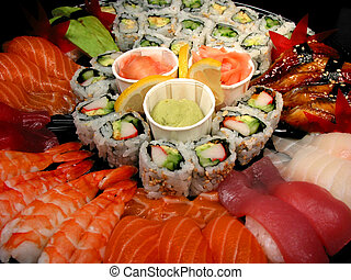 Sushi party tray, closeup - Party tray of sushi and rolls,...