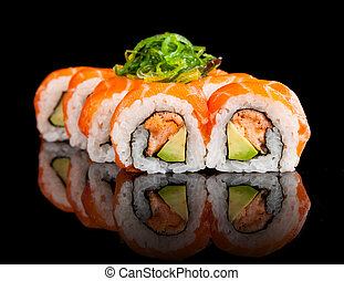 Sushi pieces on black background - Delicious sushi rolls ...