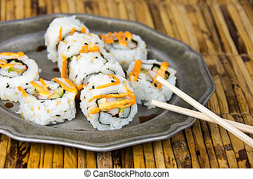 sushi pinwheel on pewter plate - sushi pinwheels and wooden...