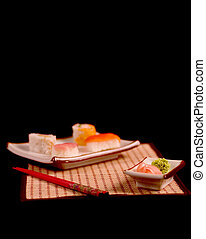 Sushi plate 2 - Sushi plate and chopsticks. Focus on wasabi...
