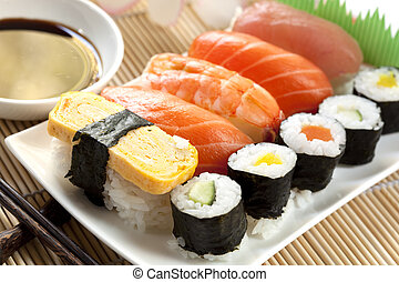 Sushi - Plate of sushi, with soy sauce and chopsticks, over...