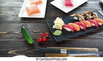 Sushi plate on wooden table.