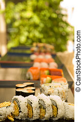 Sushi plates with shallow depth of field