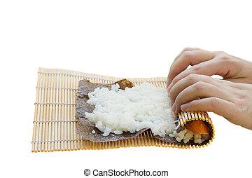 sushi preparation - rolling bamboo mat for  sushi maki roll