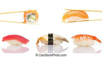 Sushi roll and nigiri in chopsticks isolated