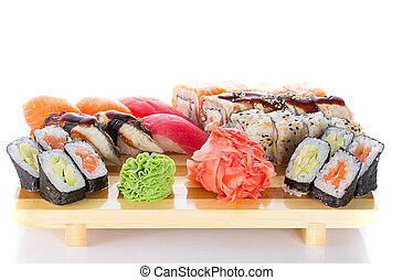 Sushi roll and nigiri on a wooden plate isolated
