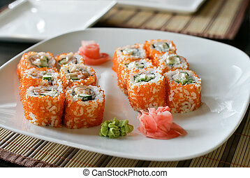 Sushi roll on the white plate