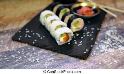 Sushi roll set with chopsticks. Japanese food.