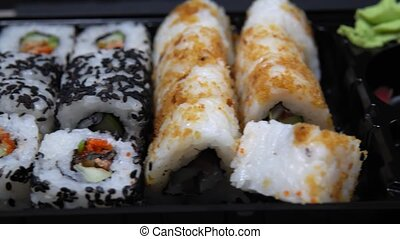 Fried Sushi Rolls with Salmon with smoked eel and caviar
