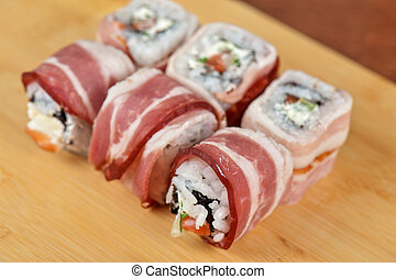 Sushi roll with bacon