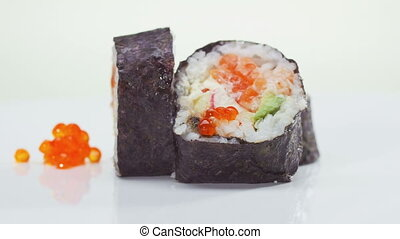 Sushi roll with salmon, avocado