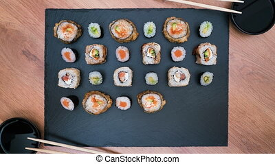 sushi rolls appear and disappear on a dish, stop motion...