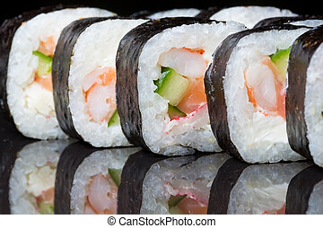 Sushi rolls Futo Maki on a black background. - Sushi rolls ...