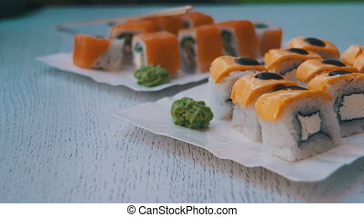 Sushi Rolls in a Restaurant on a Stylish Wooden Table