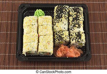 Sushi rolls in plastic container