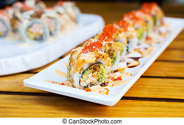 Sushi rolls on a plate in a restaurant